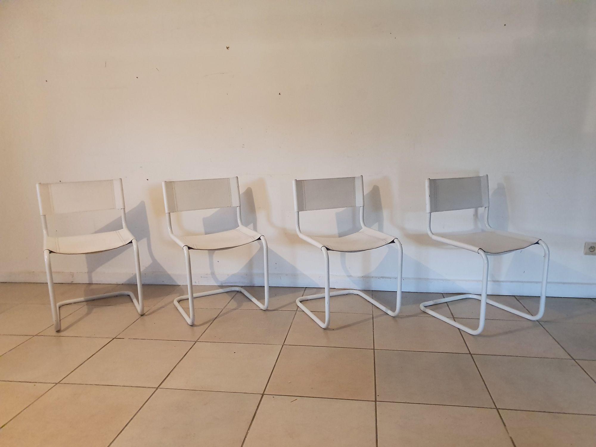 4 wit lederen stoelen